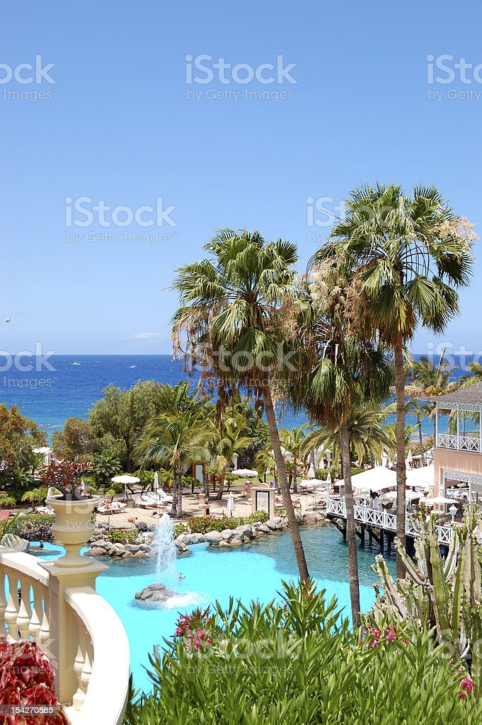 Swimming pool, open-air restaurant and beach royalty-free stock photo