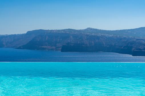 Swimming pool over Santorini caldera. Akrotiri, Santorini island, Cyclades, Greece, Europe.