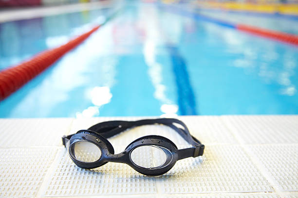 Swimming pool Image of swimming pool and goggles. Nobody swimming goggles stock pictures, royalty-free photos & images