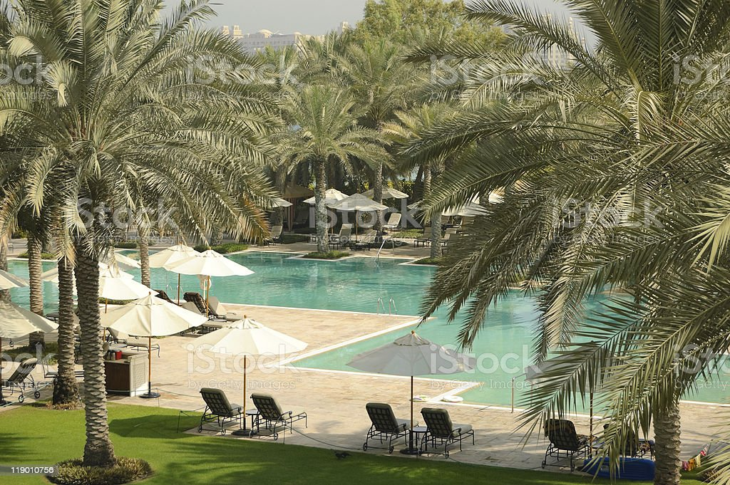 Swimming pool recreation area of luxury hotel, Dubai, UAE royalty-free stock photo