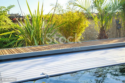 closeup on swimming pool roller-shutter covers