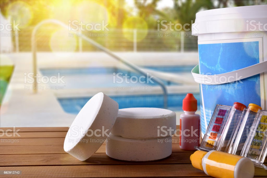 Swimming pool service and chemicals and pool background - foto de stock
