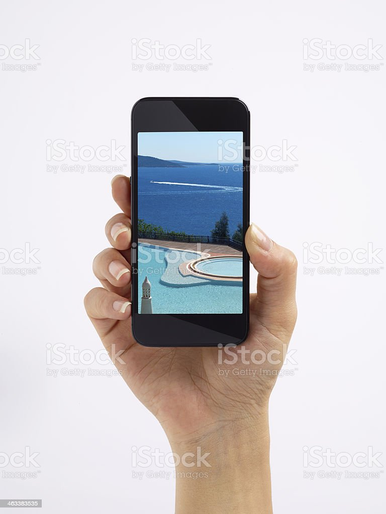 Swimming Pool Shown In Smart Phone stock photo