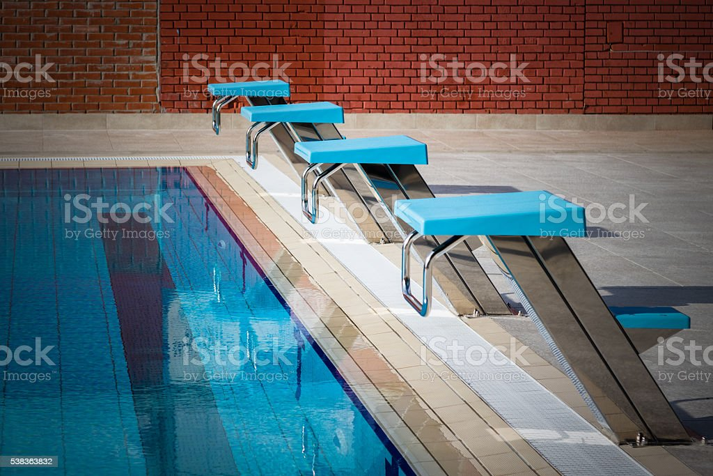 Swimming Pool Starting Blocks In A Row Stock Photo ...