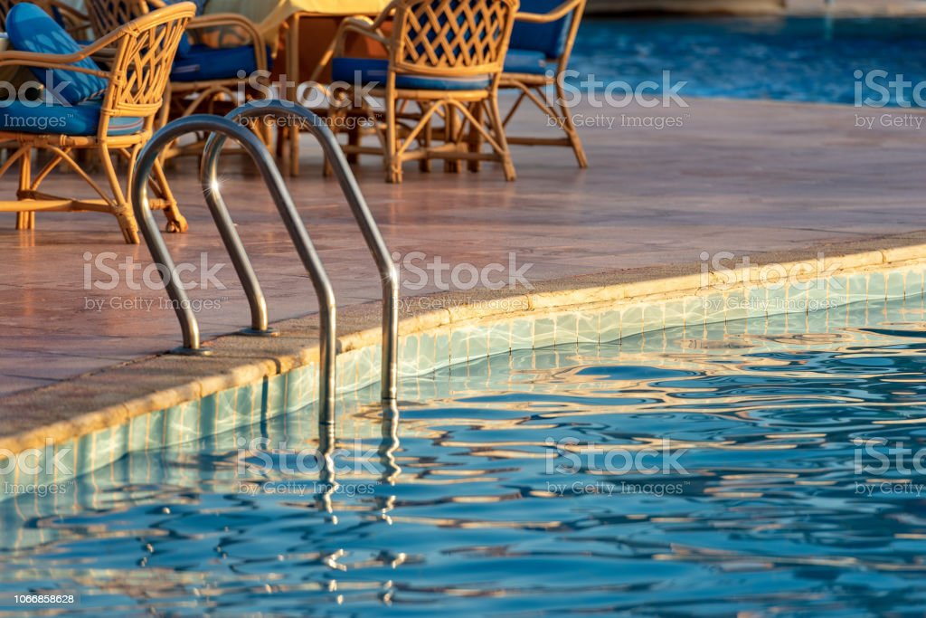 Swimming Pool Steel Ladder Chairs And Table Stock Photo ...
