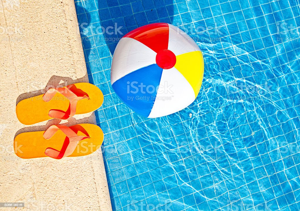 Swimming Pool Summer Fun with Floating Beach Ball, Flip Flops foto