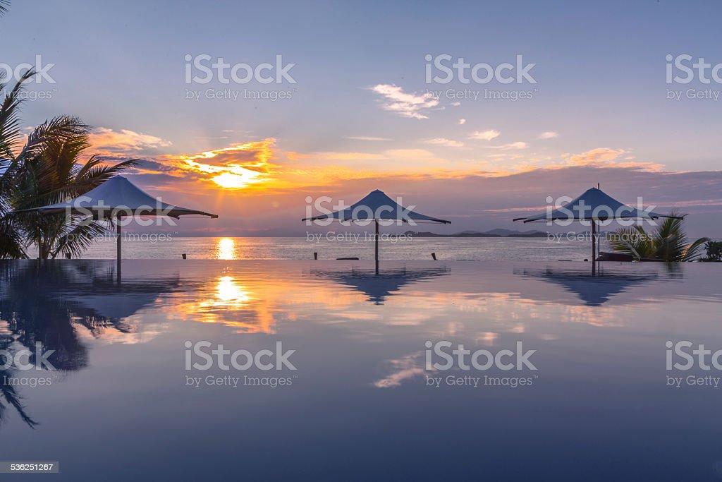 Swimming pool sunrise stock photo