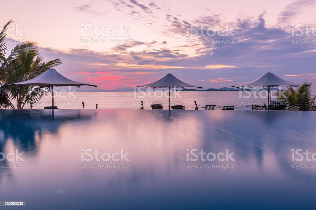 Swimming pool sunrise stock photo