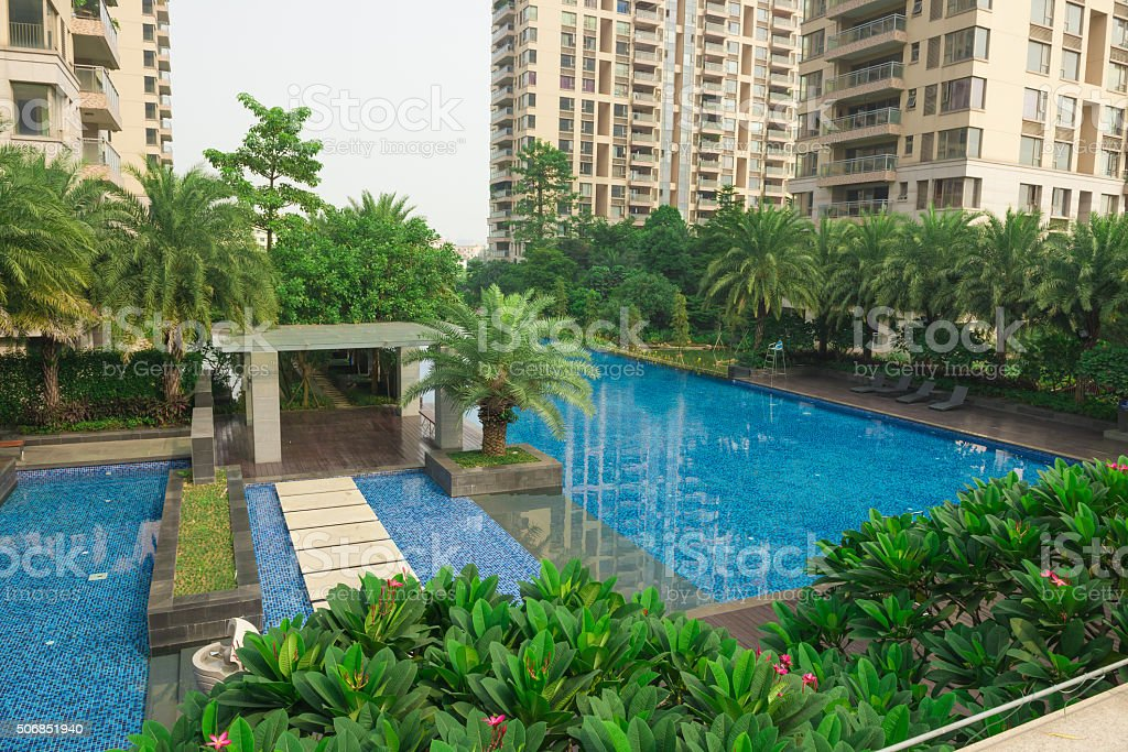 swimming pool surrounded by high residential buildings stock photo