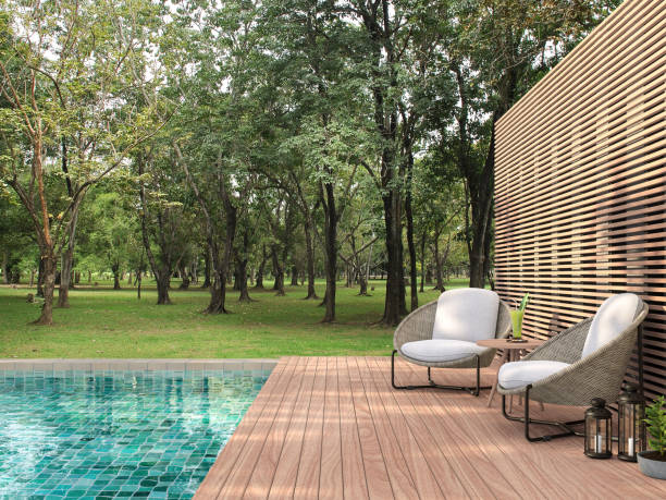 Swimming pool terrace with garden view 3d render stock photo