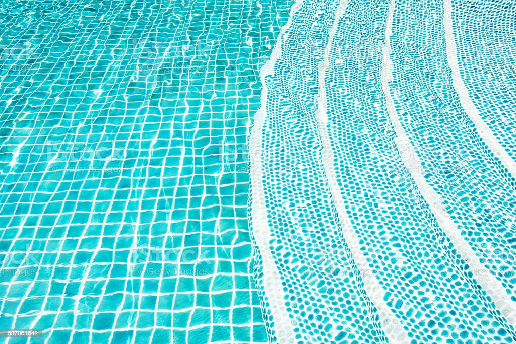Swimming pool tiled floor stairs stock photo