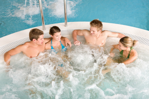 istock Swimming pool top view - people relax in hot tub 133764402