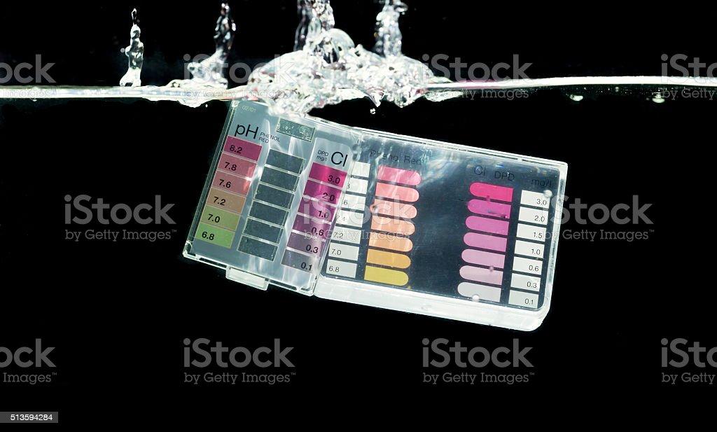 Swimming pool water testing kit stock photo