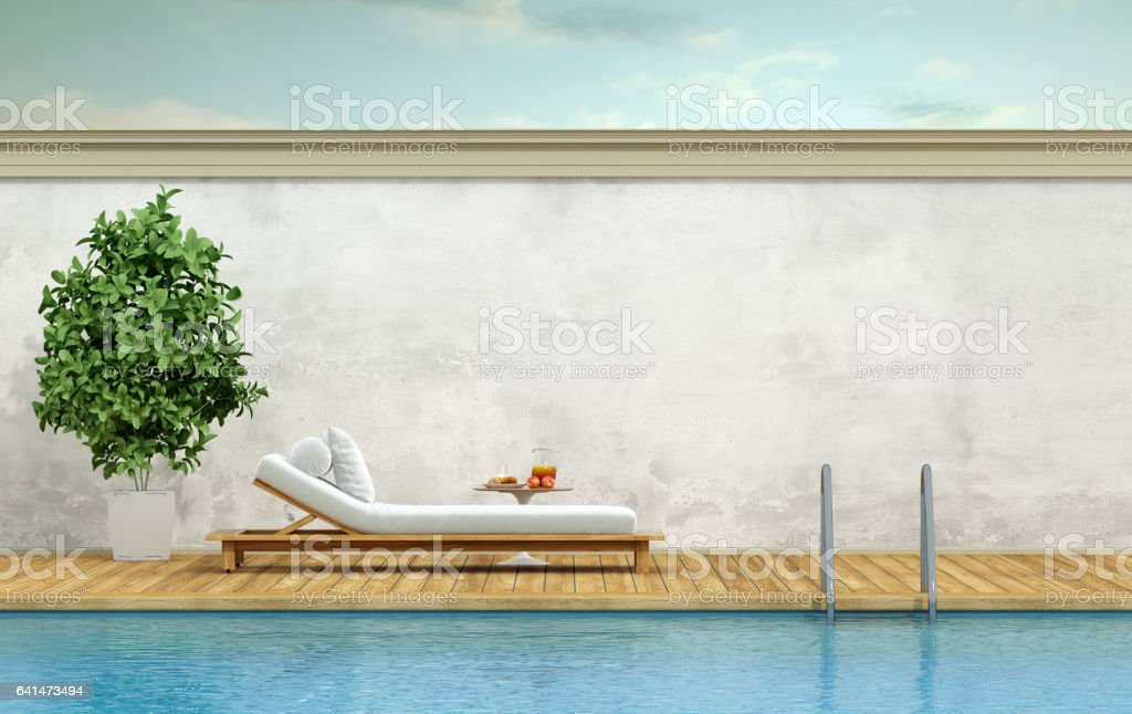 Swimming pool with chaise lounge stock photo