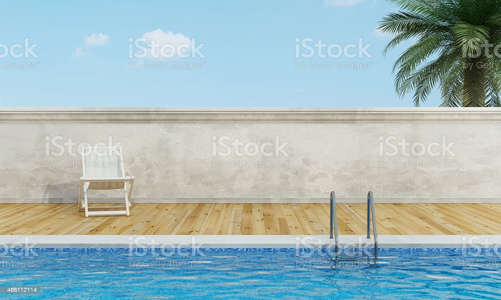 Swimming pool  with deckchair stock photo