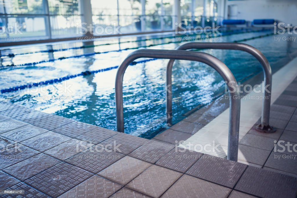 Swimming pool with hand rails stock photo