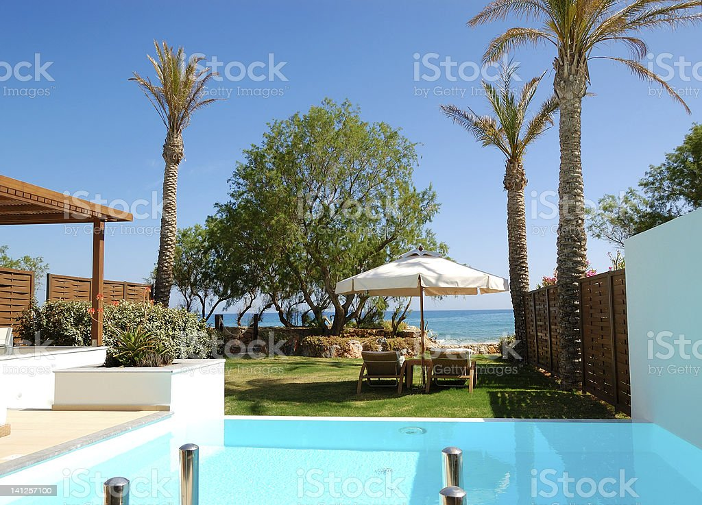 Swimming pool with jacuzzi at beach royalty-free stock photo