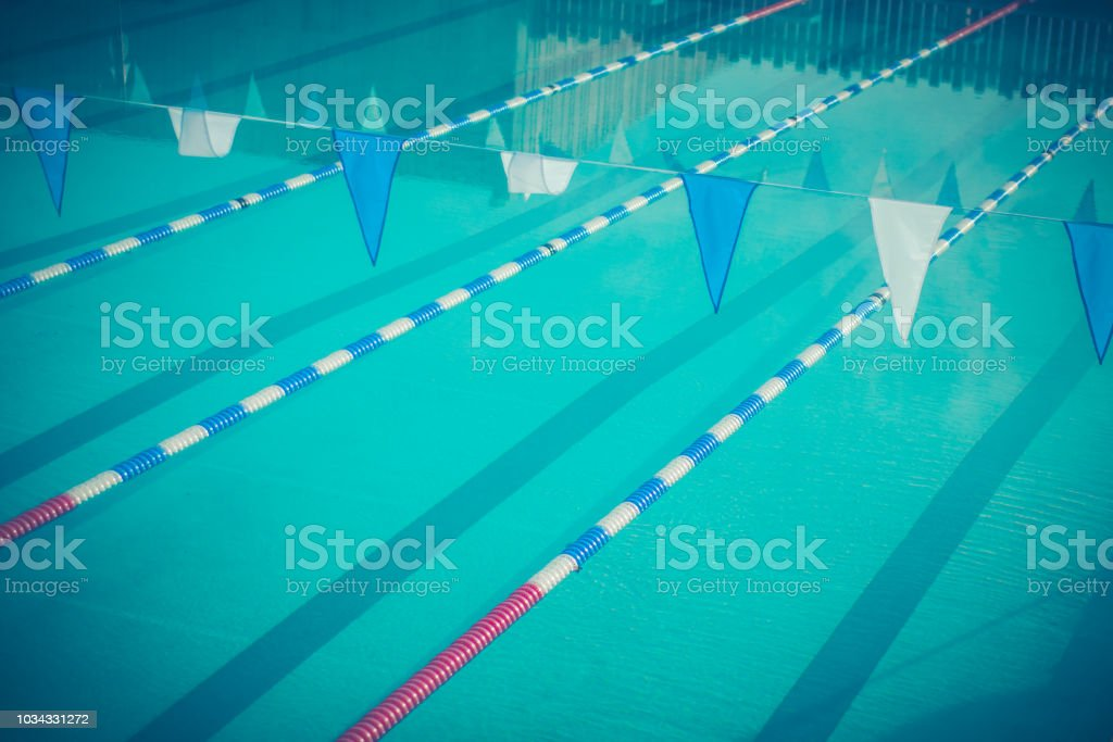 A Swimming Pool With Lane Dividers And Bunting Stock Photo ...