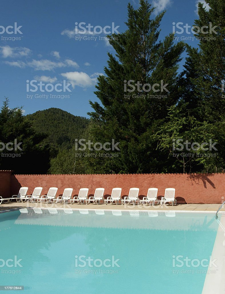 Swimming Pool with Lounge Chairs royalty-free stock photo
