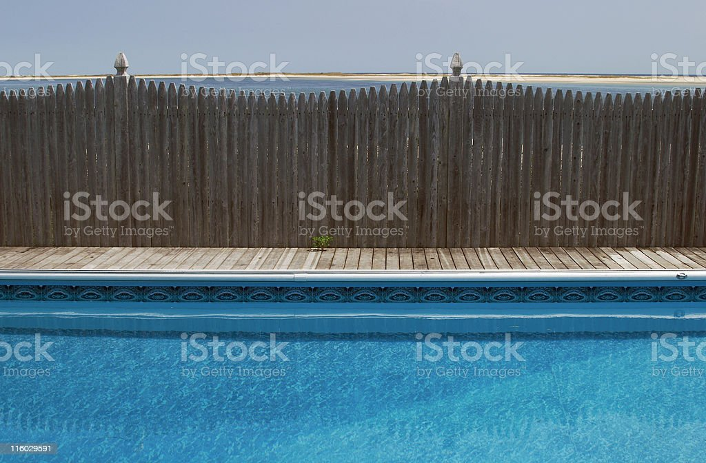 Swimming Pool With Ocean in Distance, Water Sports, Relaxation, Serene royalty-free stock photo