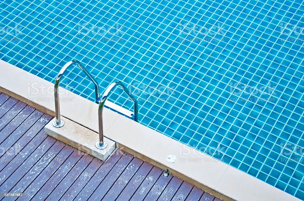 Swimming pool with stair and wooden deck stock photo