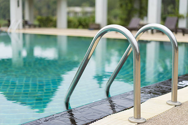 swimming pool with stair at hotel - competition group stock photos and pictures
