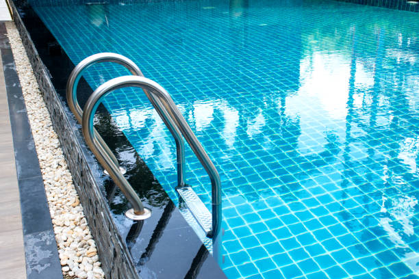 Swimming pool with stair in hotel Swimming pool with stair in hotel Swimming pool stock pictures, royalty-free photos & images