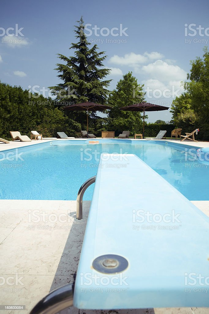 Swimming pool with trampoline stock photo