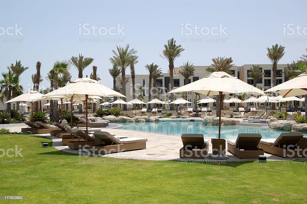 Swimming pools and beach at luxury hotel, Saadiyat island stock photo