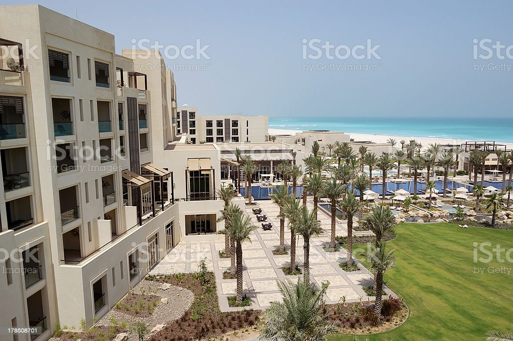 Swimming pools and beach at the luxury hotel stock photo
