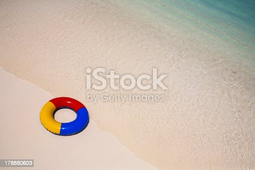 istock swimming ring at the beach 178880603