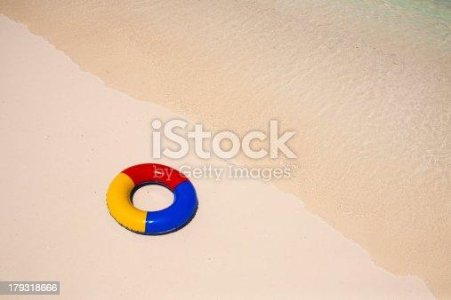 istock swimming ring athe beach 179318666