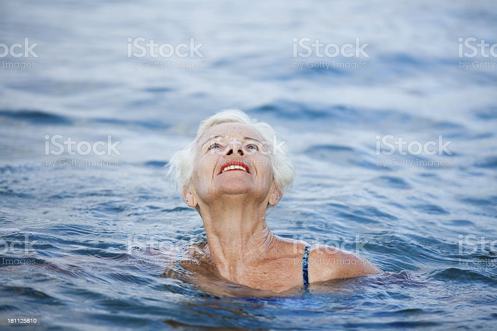 Swimming senior woman looking up with hope royalty-free stock photo