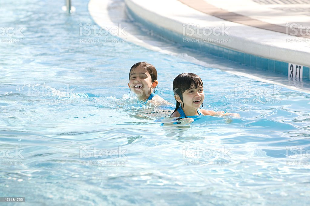 Swimming Sisters royalty-free stock photo