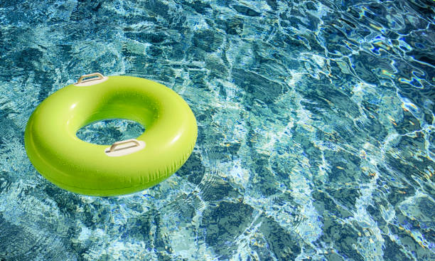 Swimming, summer vacation, pool float stock photo