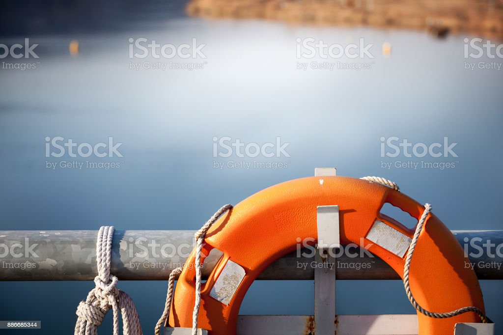swimming tube at bridge over river, lifebuoy tube stock photo