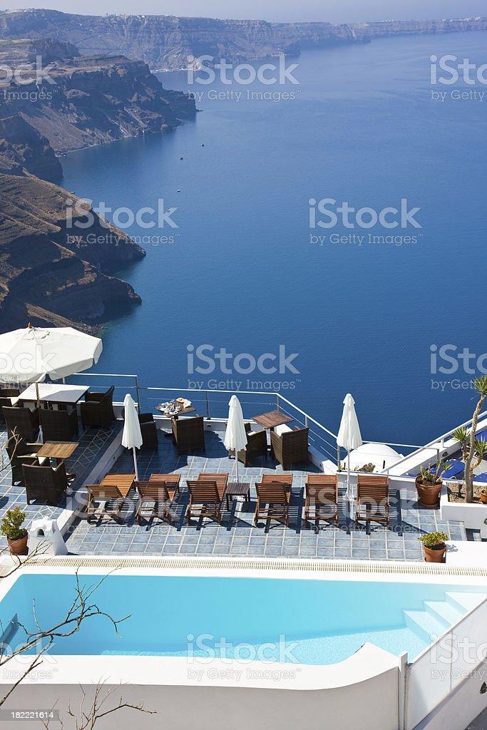 swimmingpool sunbeds and umbrellas royalty-free stock photo