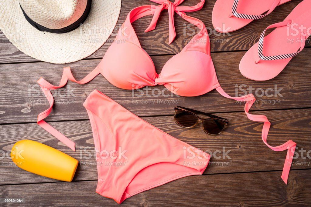 Swimsuit on wooden background stock photo
