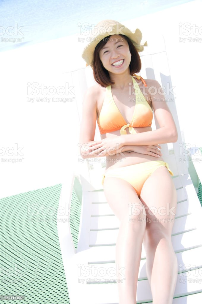 Swimsuit women lounging on deck chairs royalty-free stock photo