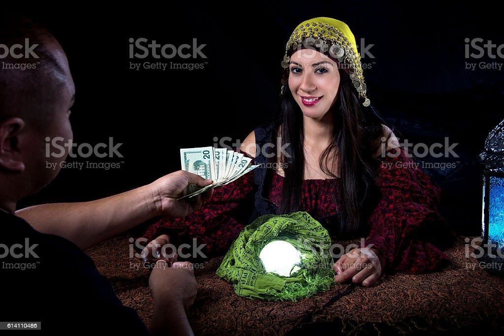 Swindler Gypsy Fortune Teller Committing Fraud Stock Photo
