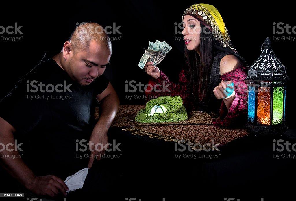 Swindler Gypsy Fortune Teller Committing Fraud stock photo
