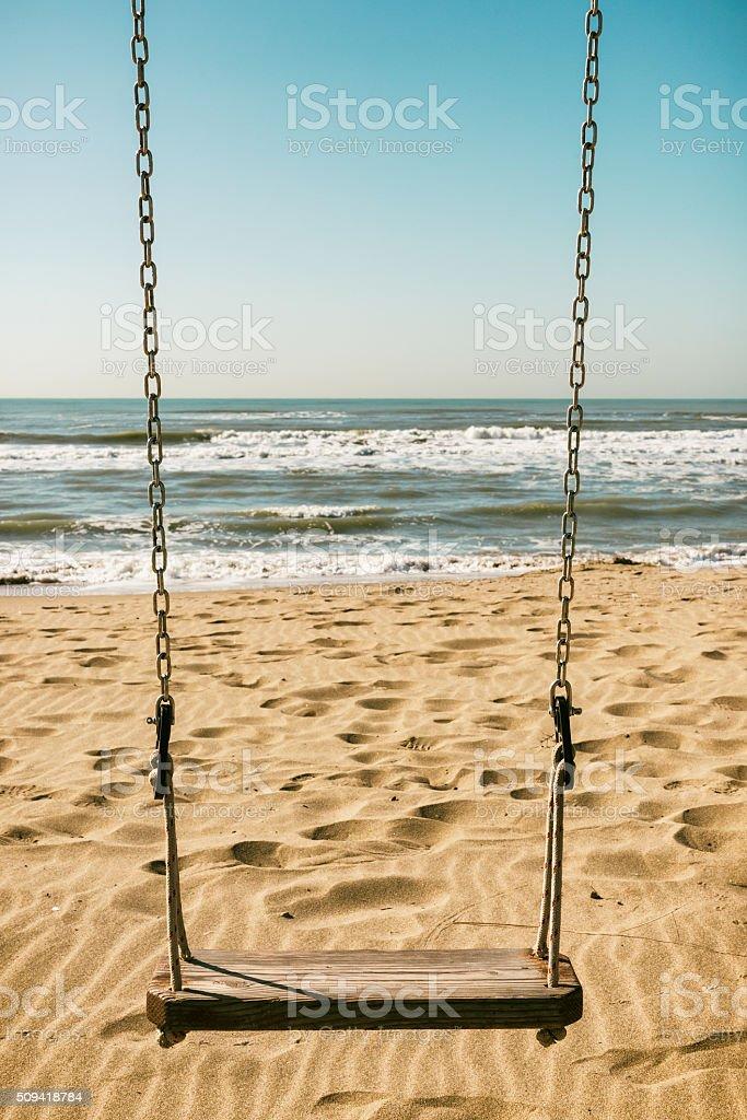 Swing at the beach stock photo