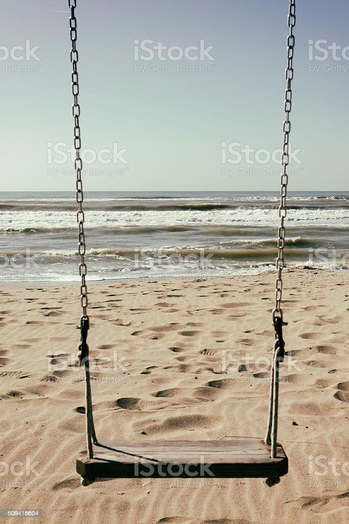 Swing at the beach, retro colours stock photo