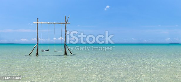 Swing at tropical sea on sunny day and blue sky.