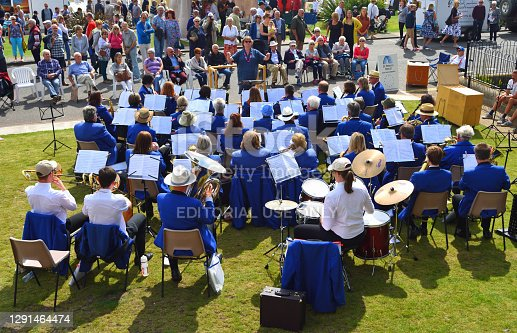 istock Swing band in blue jackets playing outdoors . 1291464474