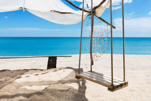Swing by the azure sea stock photo