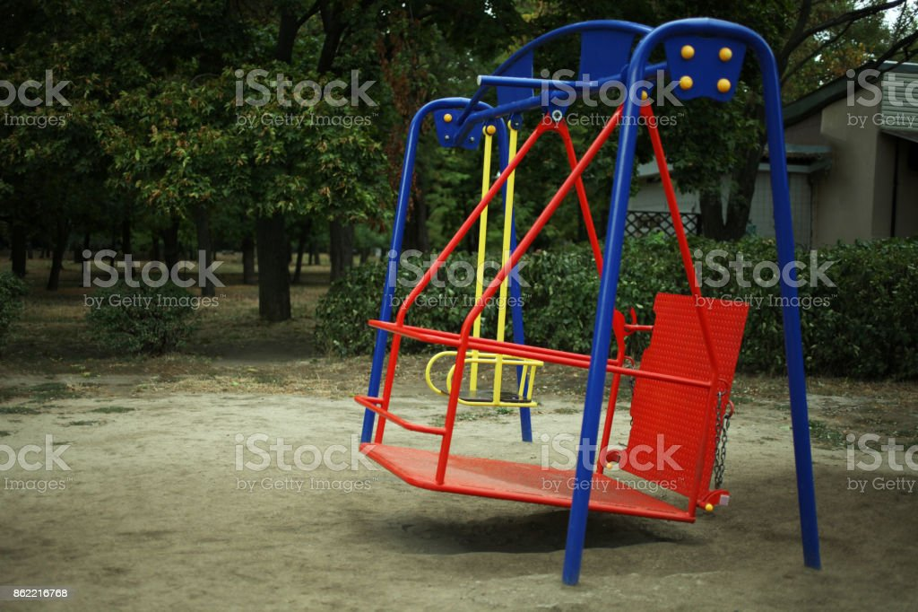 swing for children with disabilities in the park stock photo