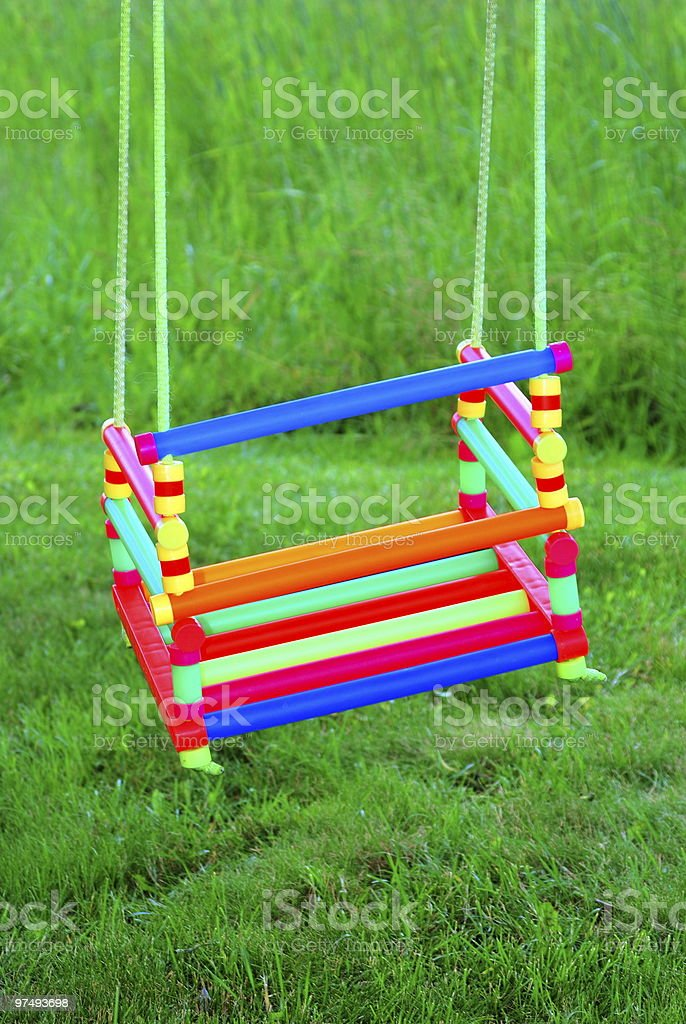swing in a green background royalty-free stock photo