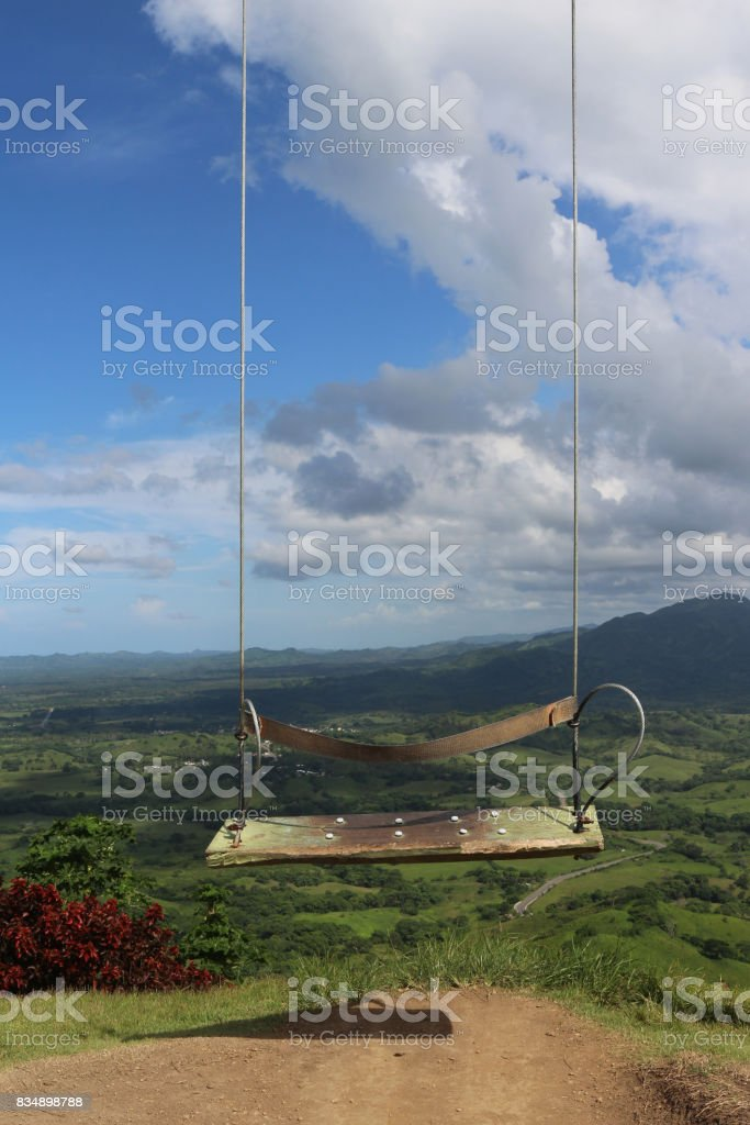 Swing in front of a beautiful landscape stock photo
