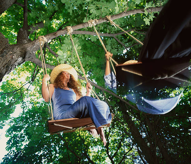 Swing in the greenwood A swinging couple in the greenwood grifare stock pictures, royalty-free photos & images